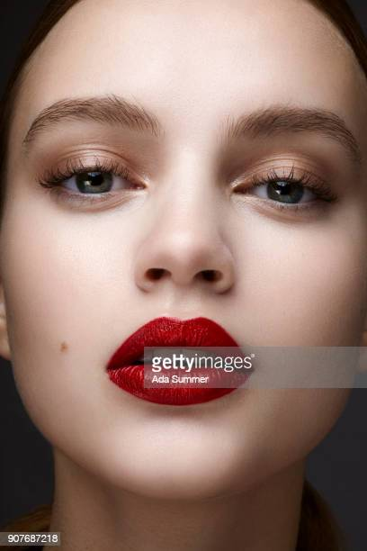 studio shot of a beautiful young woman - red lipstick stock pictures, royalty-free photos & images