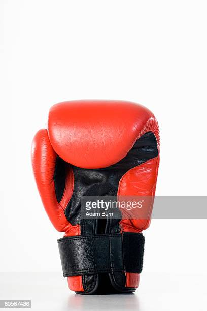 studio shot of a boxing glove - boxing gloves stock photos and pictures
