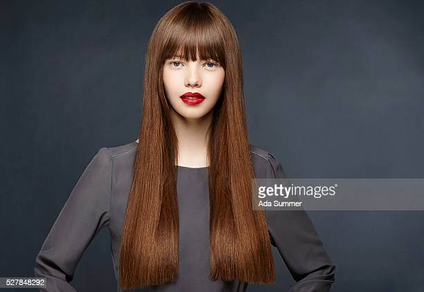 studio shot of a brunette with long straight hair