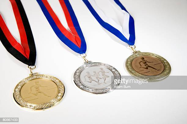 studio shot of a gold medal, silver medal and a bronze medal - silver medalist stock pictures, royalty-free photos & images