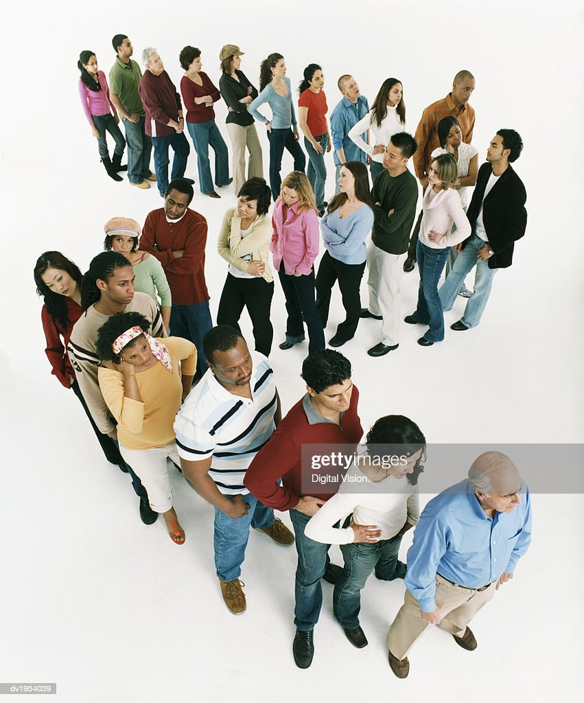 Studio Shot of a Large Mixed Age, Multiethnic Group of Bored Men and Women Waiting in Line : Stock Photo
