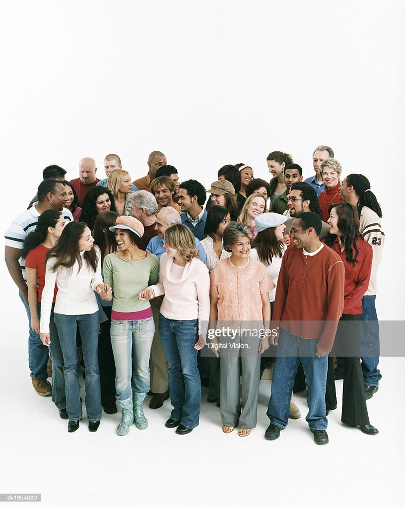 Studio Shot of a Large Mixed Age, Multiethnic Group of Men and Women Talking to Each Other : Stock Photo