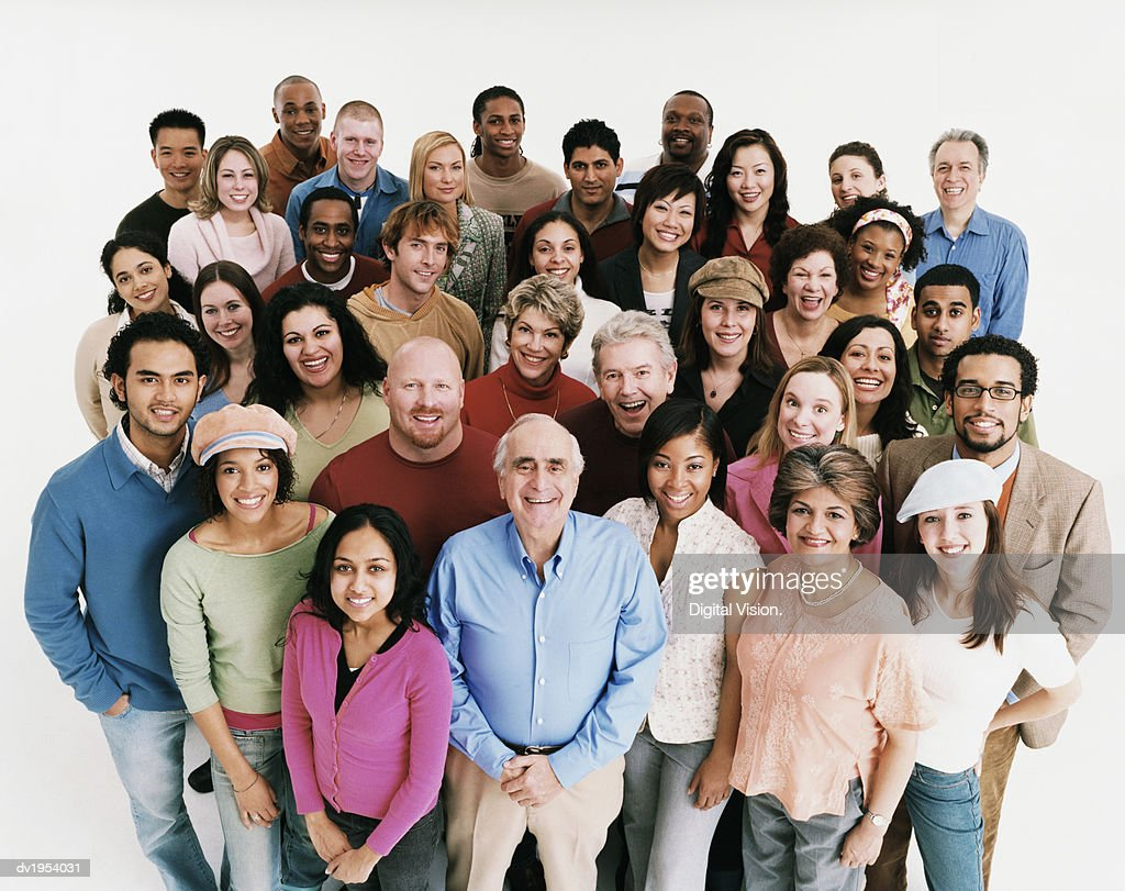 Studio Shot of a Large Mixed Age, Multiethnic Group of Smiling Men and Women : Stock Photo