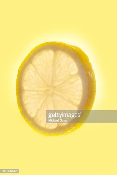 studio shot of a lemon on yellow background
