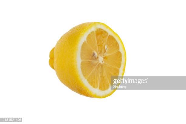 studio shot of a lemon - 果肉 ストックフォトと画像