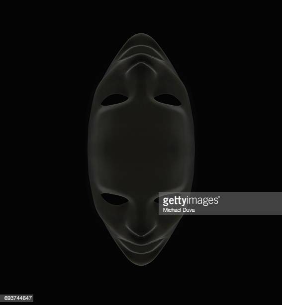 studio shot of a mask on black background - black mask disguise stock pictures, royalty-free photos & images