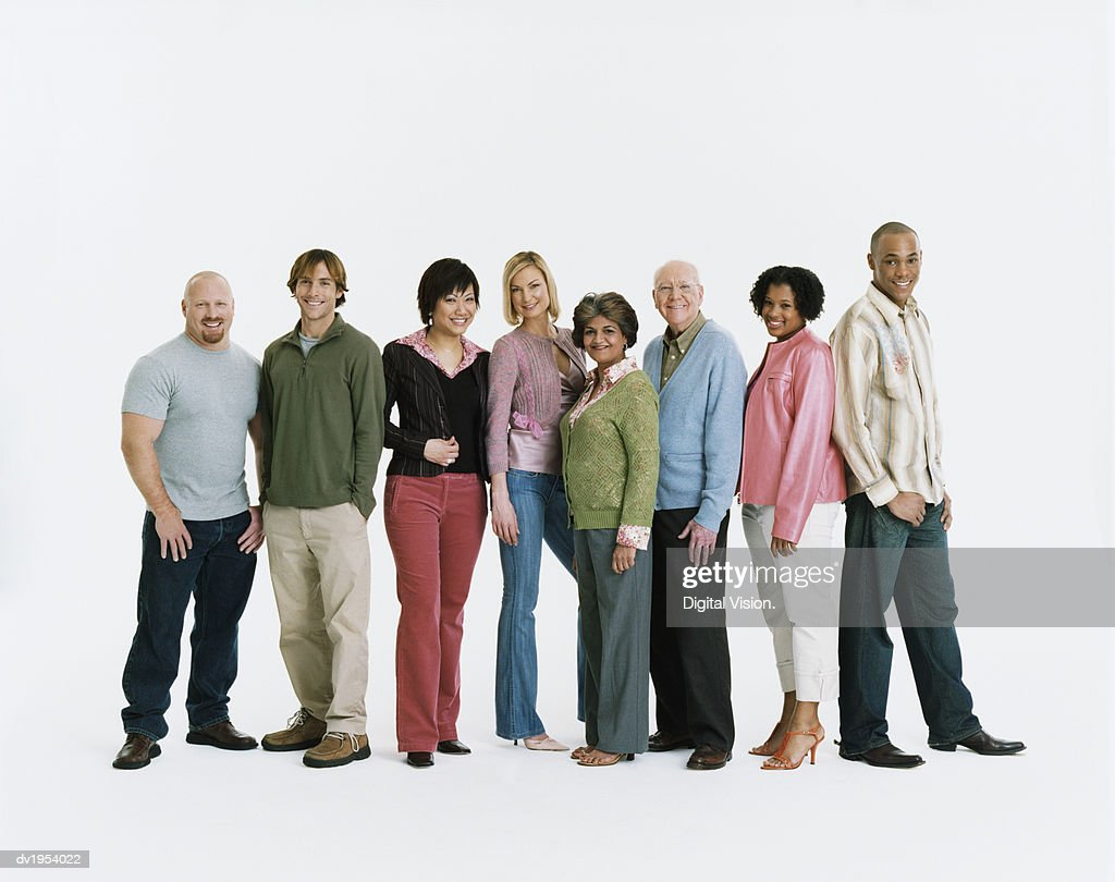 Studio Shot of a Mixed Age, Multiethnic Group of Men and Women Standing in a Line : Stock Photo