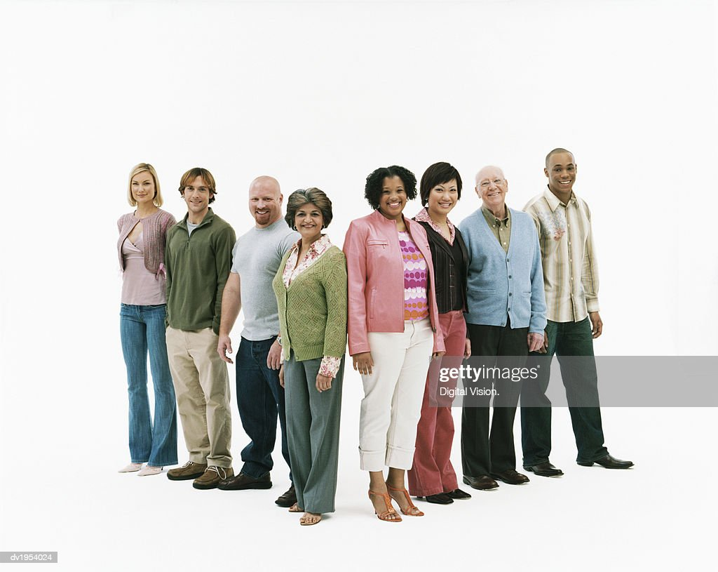 Studio Shot of a Mixed Age, Multiethnic Group of Men and Women Standing in a V Shape : Stock Photo