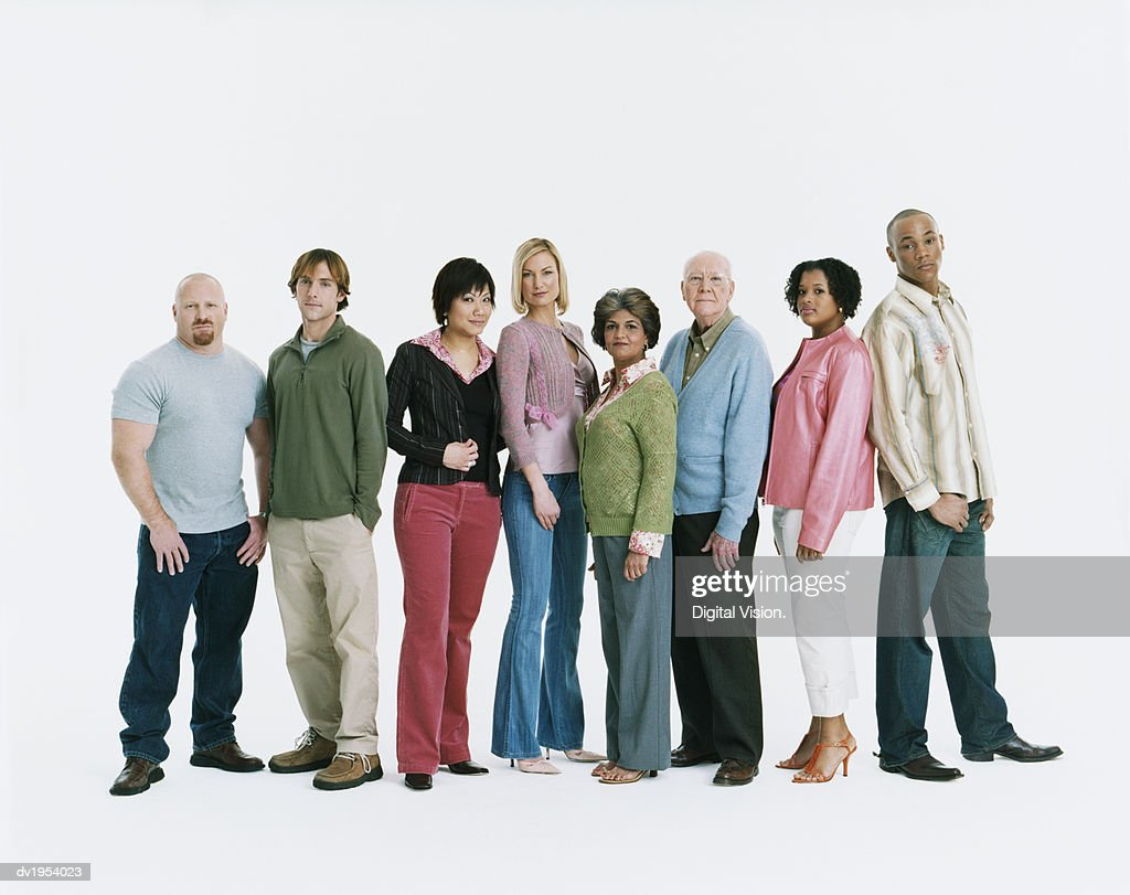 Studio Shot of a Mixed Age, Multiethnic Group of Serious Men and Women Standing in a Line : Stock Photo