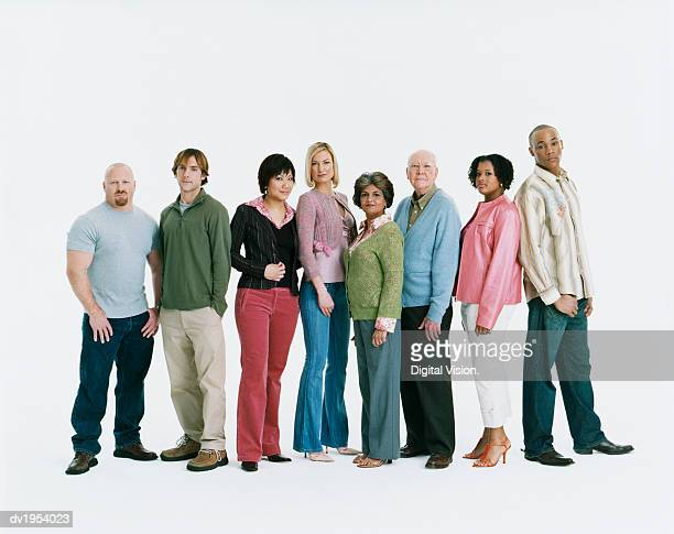 studio shot of a mixed age, multiethnic group of serious men and women standing in a line - menschenreihe stock-fotos und bilder