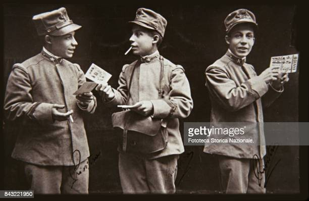 A studio shot of a postman distributing military mail including a postal order usually sent to soldiers' families as economical support Italy approx...