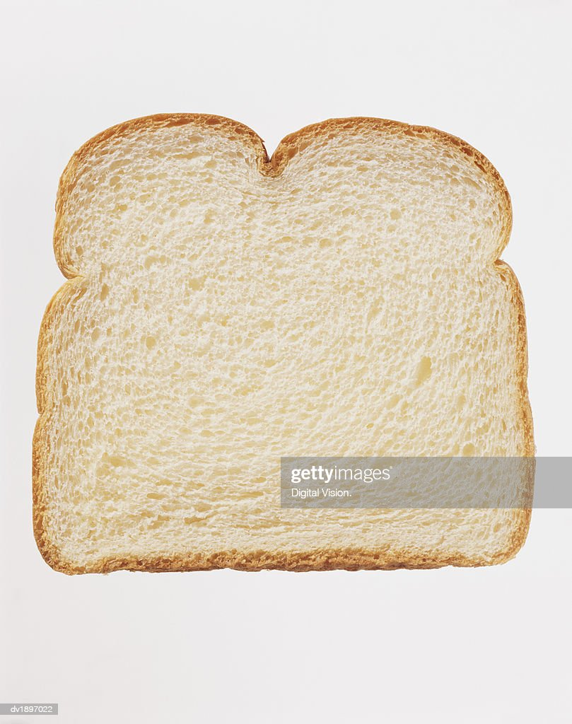 Studio Shot of a Slice of White Bread Against a White Background : Stock Photo