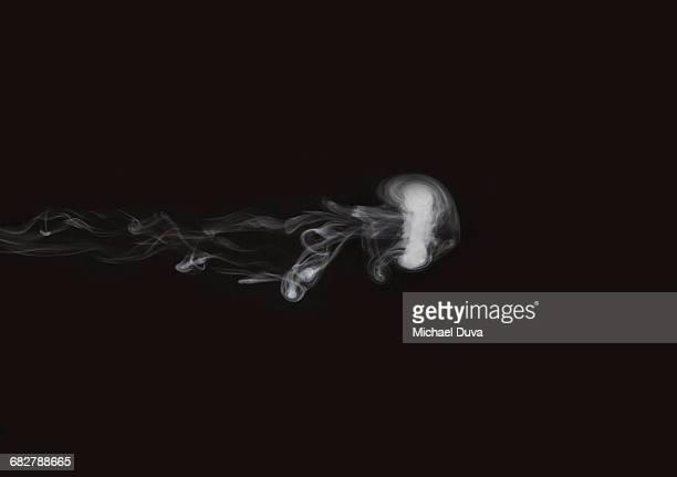 studio shot of a smoke ring moving across screen