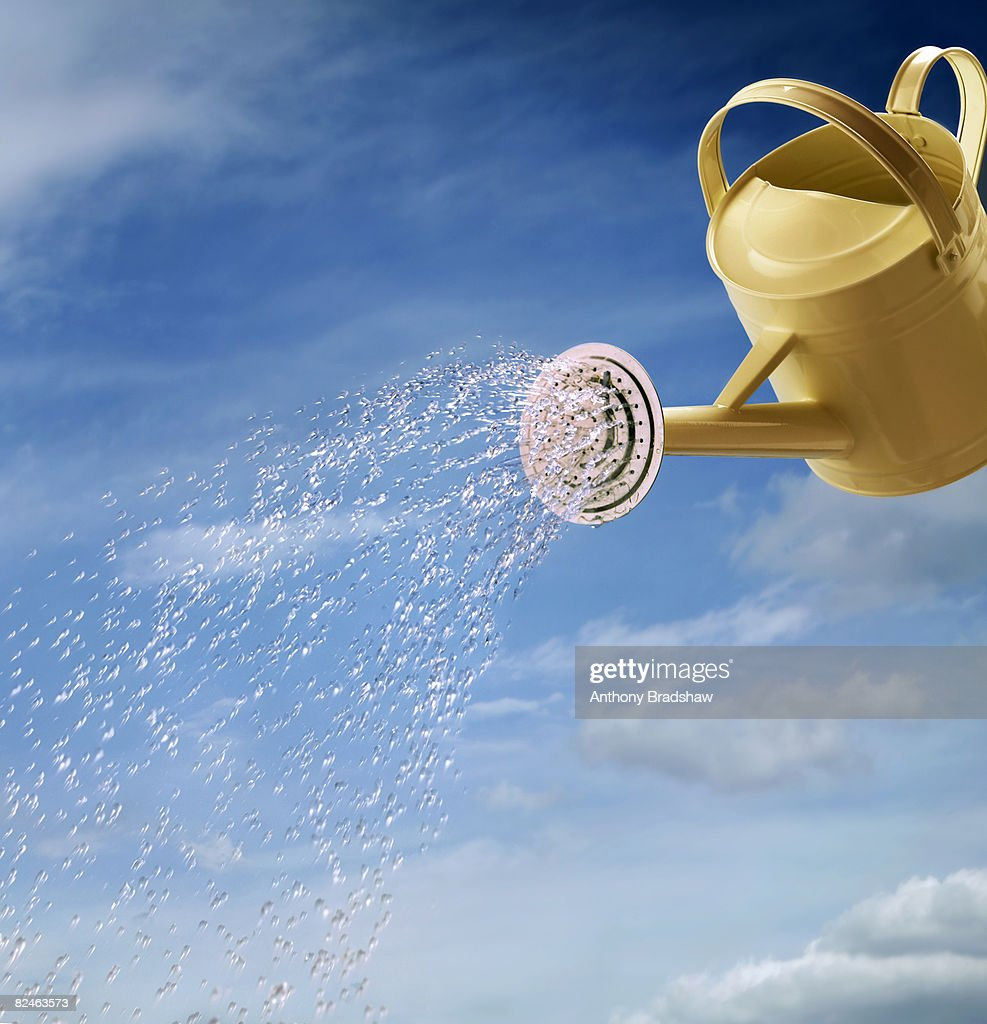 Studio shot of a watering can, on a sky background : Stock Photo
