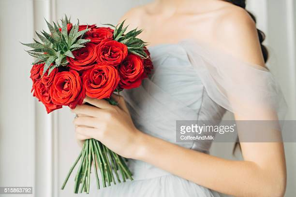 studio shot of a wedding bouquet - red roses stock pictures, royalty-free photos & images