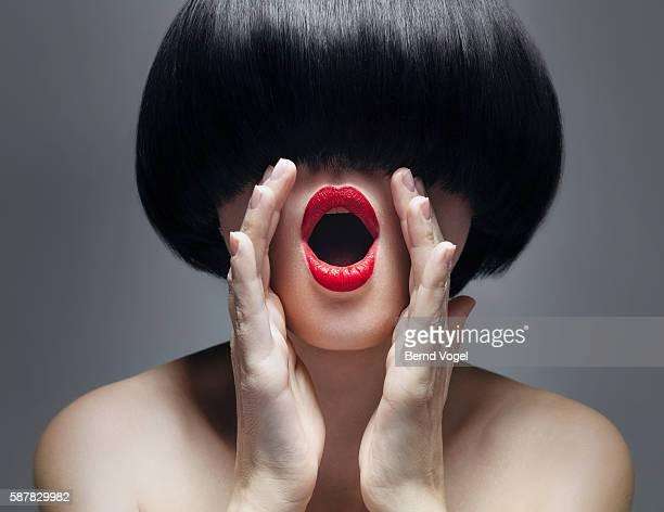 Studio shot of a woman with a round haircut and red lips