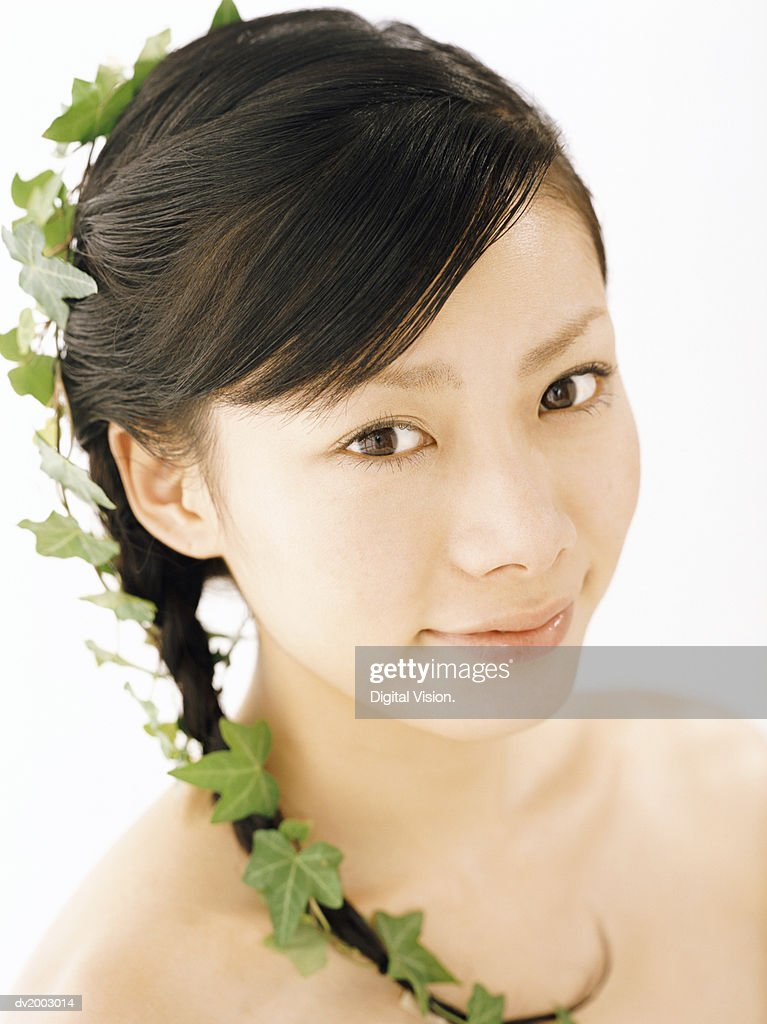 Studio Shot of a Woman With Leaves in Her Hair : Stock Photo