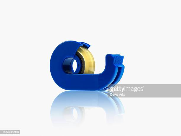 studio shot of adhesive tape - tape dispenser stock photos and pictures