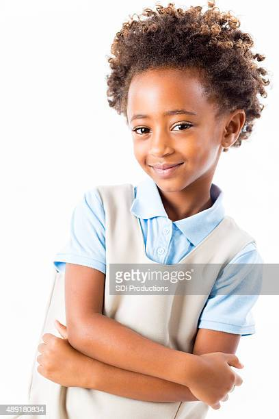 Studio shot of African American private elementary schoolgirl in uniform