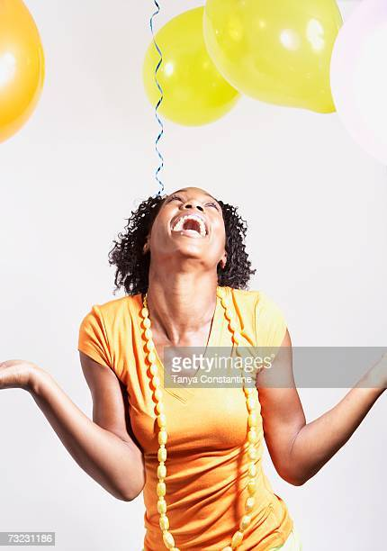 Studio shot of African woman laughing with balloons