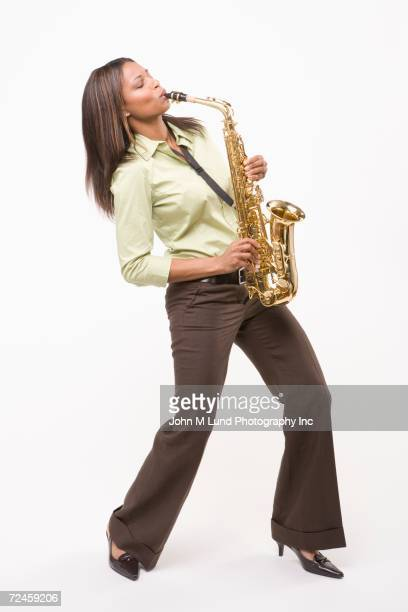 Studio shot of African woman playing saxophone
