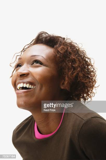 Studio shot of African woman smiling and looking up