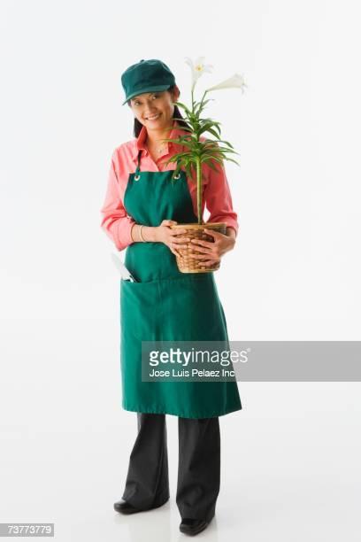 Studio shot of Asian female gardener