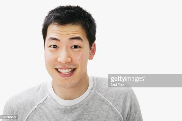 Studio shot of Asian man smiling