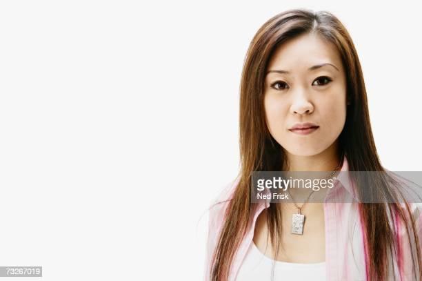 Studio shot of Asian woman looking serious