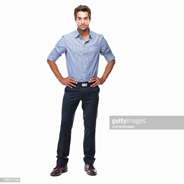 studio shot of attractive business man standing with hands on hips - handen op de heupen stockfoto's en -beelden