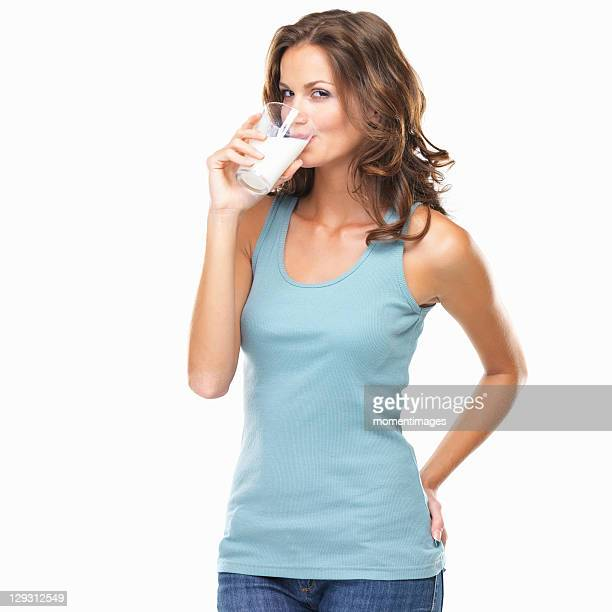 Studio shot of attractive young woman drinking milk