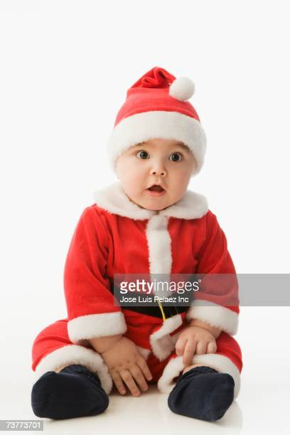 studio shot of baby wearing santa claus outfit - 民族衣装 ストックフォトと画像