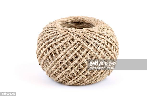 Studio Shot Of Ball Of String Against White Background