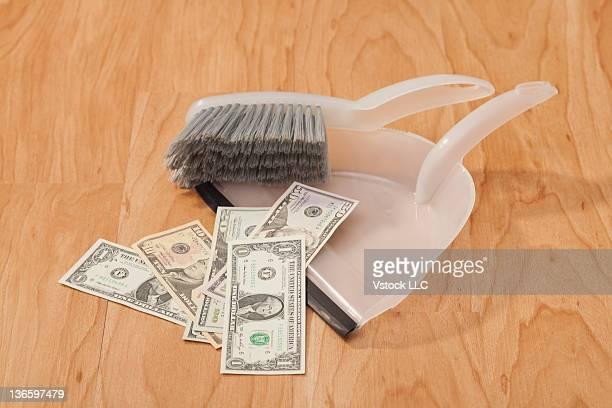 Studio shot of banknotes on dust pan