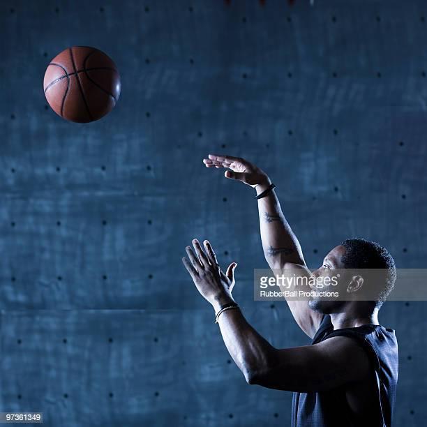 Studio shot of basketball player holding ball
