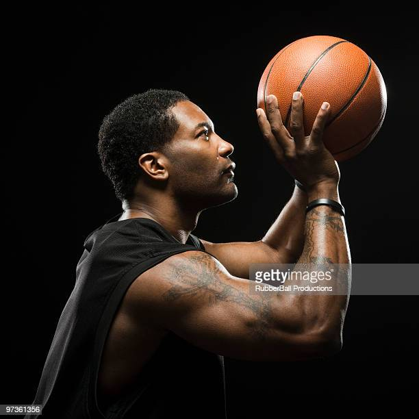 Studio shot of basketball player holding ball