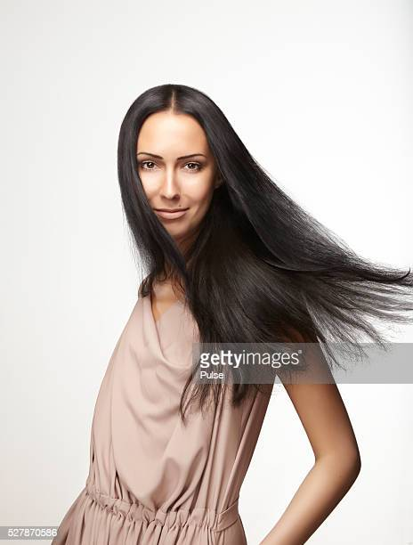studio shot of beautiful brunette. - straight hair stock pictures, royalty-free photos & images