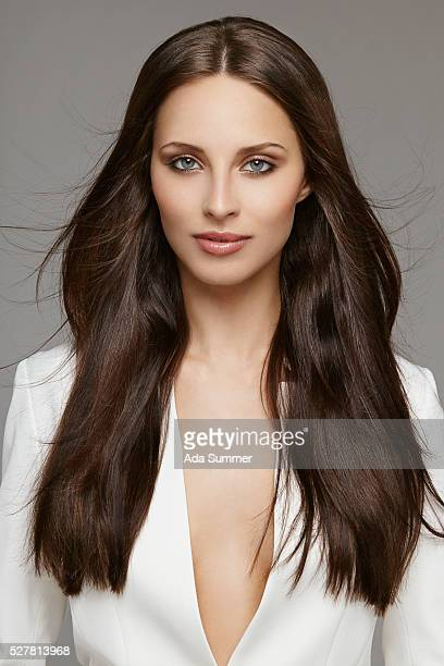 studio shot of beautiful brunette woman - straight hair stock pictures, royalty-free photos & images