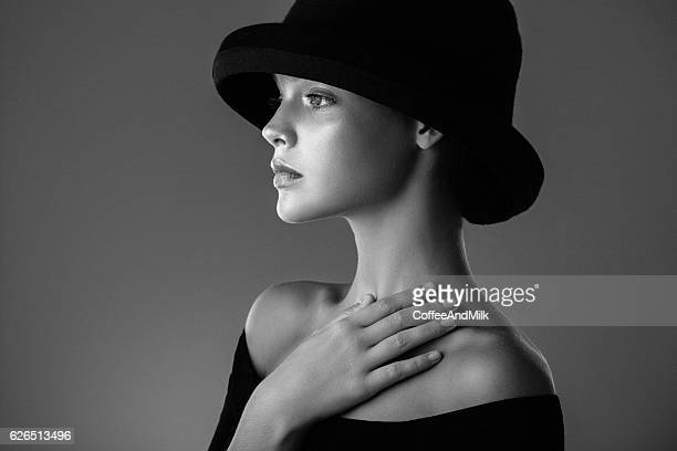Studio shot of beautiful woman wearing black hat