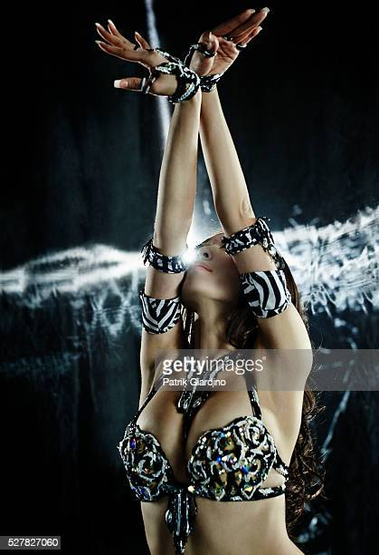 studio shot of belly dancer in sensual pose - belly dancing stock photos and pictures