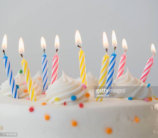 studio shot of birthday cake with lit candles - birthday cake stock pictures, royalty-free photos & images