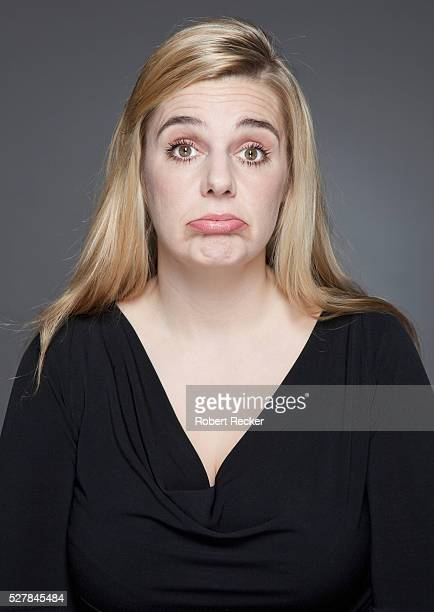 studio shot of blond haired woman making face - funny fat women stock pictures, royalty-free photos & images