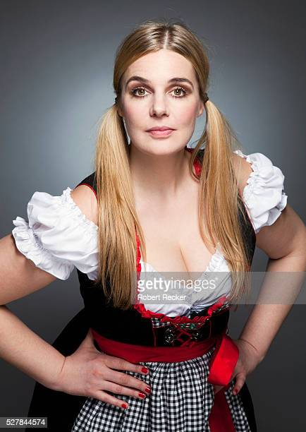 studio shot of blond haired woman - large breasts stock pictures, royalty-free photos & images