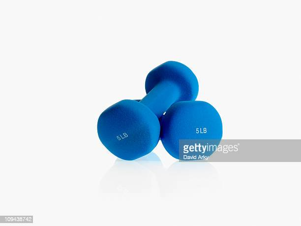 Studio shot of blue dumpbells