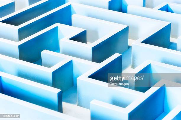 studio shot of blue maze - maze stock photos and pictures