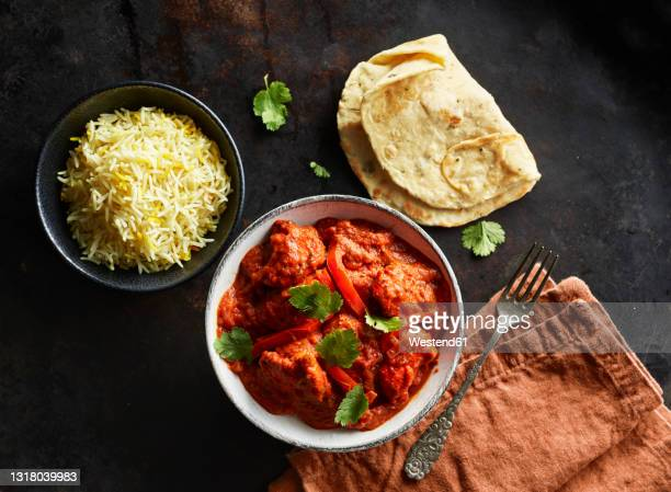 studio shot of bowl of chicken tikka, bowl of basmati rice and naan bread - tikka masala stock pictures, royalty-free photos & images