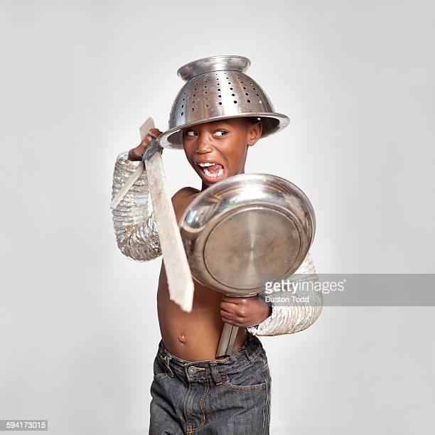 Studio shot of boy (6-7) wearing warrior costume