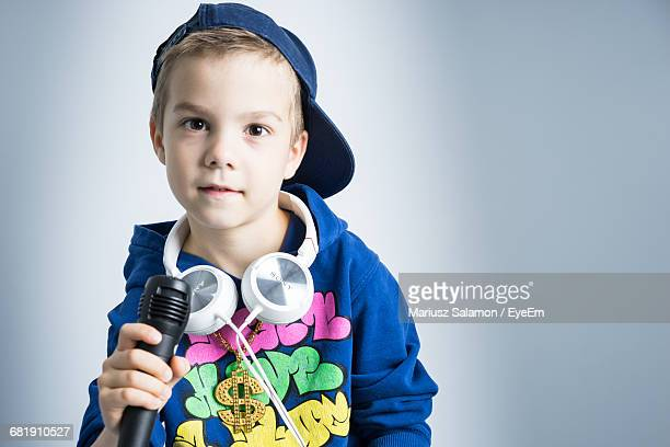 Studio Shot Of Boy With Microphone And Headphones