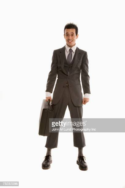 Studio shot of businessman wearing suit that is too small