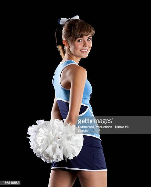 studio shot of cheerleader (16-17) striking pose - cheerleader up skirt stock photos and pictures